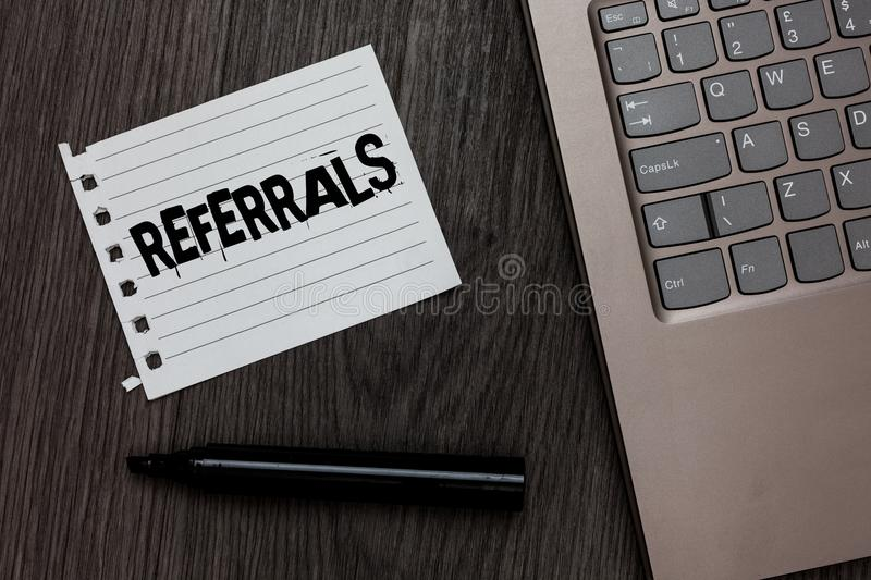 Word writing text Referrals. Business concept for Act of referring someone or something for consultation review Laptop nice comput. Er notebook netbook pen small royalty free stock photos