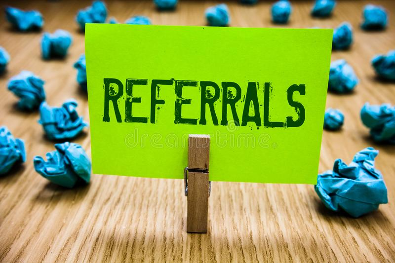Word writing text Referrals. Business concept for Act of referring someone or something for consultation review Paper cyan object. Thoughts crumpled papers stock image