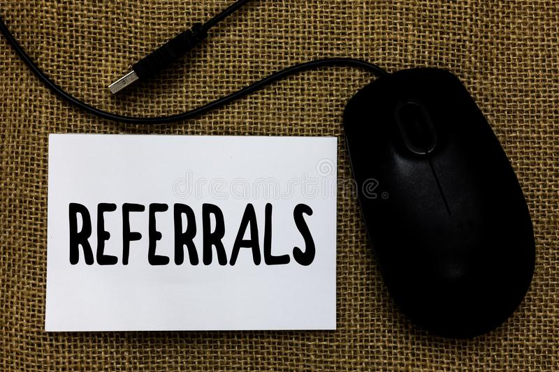 Word writing text Referrals. Business concept for Act of referring someone or something for consultation review USB cable mouse ar. T paper mat thoughts ideas royalty free stock image