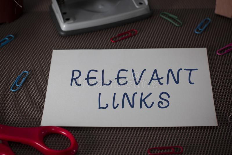 Word writing text Relevant Links. Business concept for Significant sites for a particular topic Associated Scissors and. Word writing text Relevant Links stock image