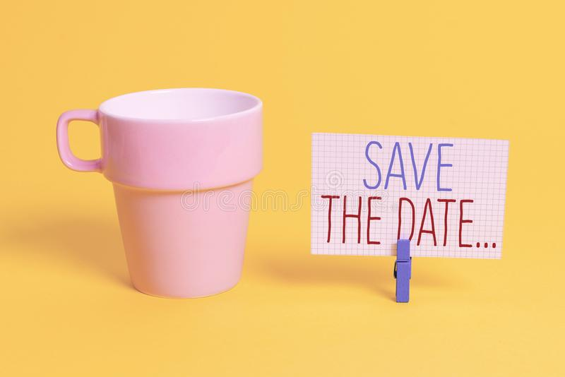 Word writing text Save The Date. Business concept for Organizing events well make day special event organizers Cup empty. Word writing text Save The Date stock photography
