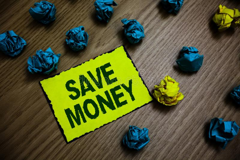 Word writing text Save Money. Business concept for store some of your cash every month to use them sometime later Yellow piece pap. Er reminder lots crumpled royalty free stock images