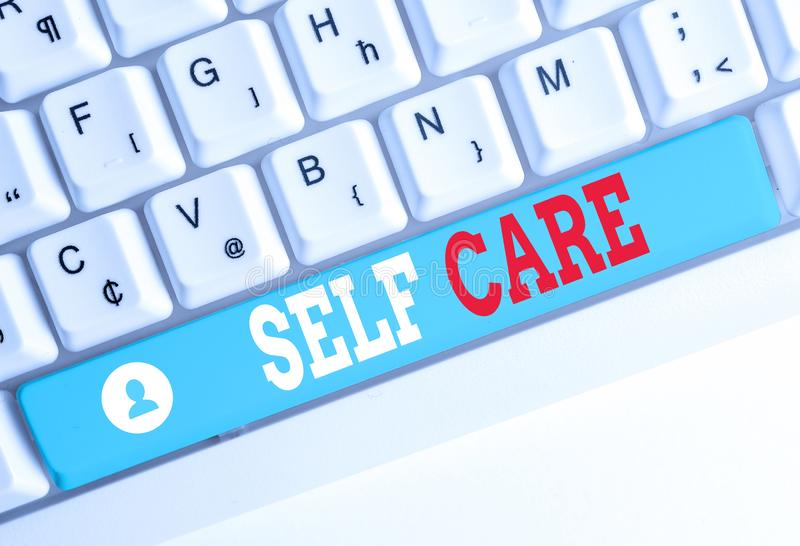 Word writing text Self Care. Business concept for the practice of taking action to improve one s is own health White pc keyboard. Word writing text Self Care stock photography