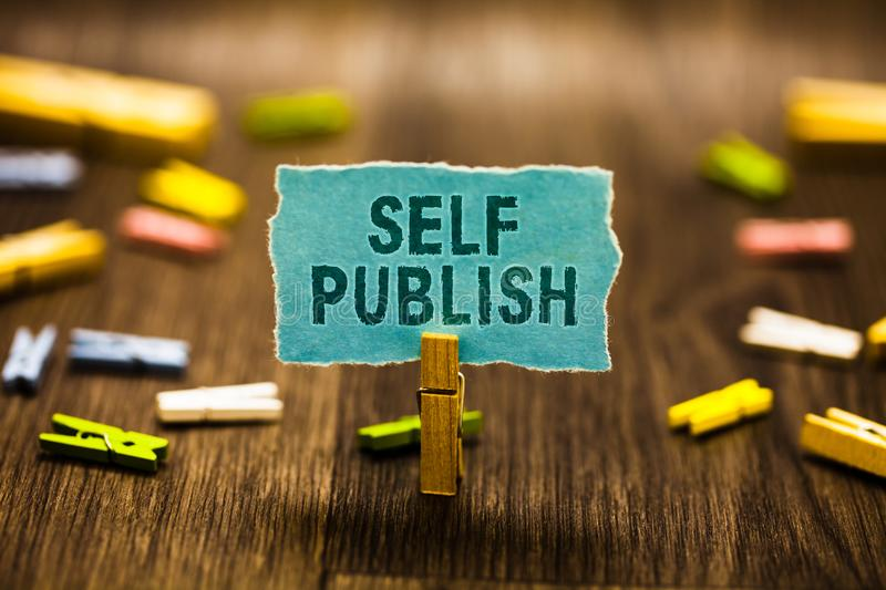 Word writing text Self Publish. Business concept for Published work independently and at own expense Indie Author Clothespin holdi stock image