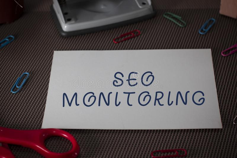 Word writing text Seo Monitoring. Business concept for Tracking the progress of strategy made in the platform Scissors. Word writing text Seo Monitoring royalty free stock image