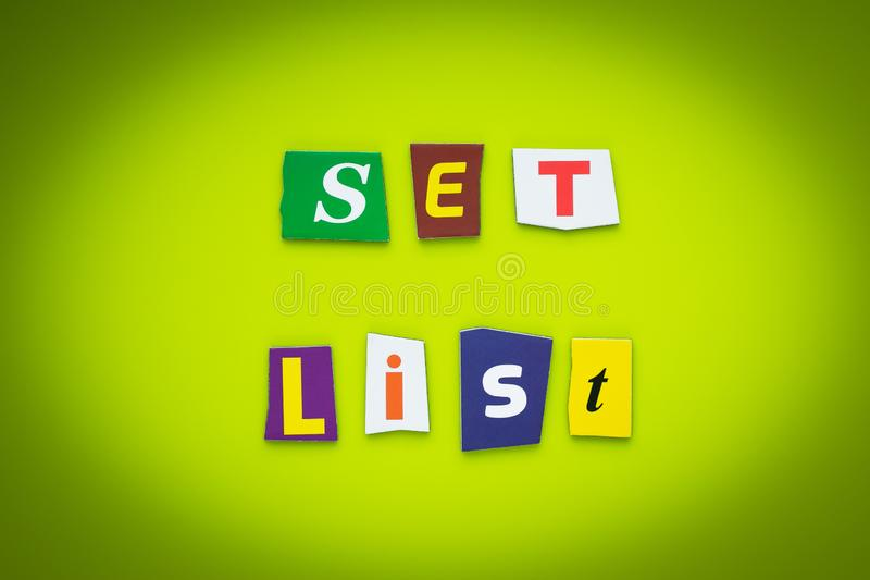 A word writing text - set list. Cutted letters on green background. Headline on bright banner. Colorful inscription on a board, pa. Per. Message on poster stock image