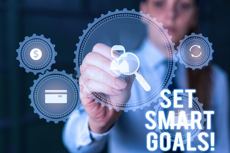Word writing text Set Smart Goals. Business concept for list to clarify your ideas focus efforts use time wisely Woman. Word writing text Set Smart Goals stock image