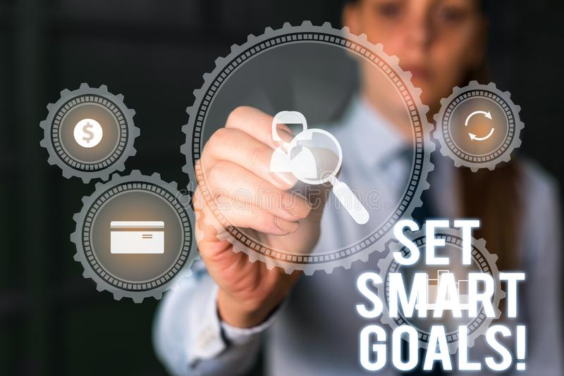 Word writing text Set Smart Goals. Business concept for list to clarify your ideas focus efforts use time wisely Woman. Word writing text Set Smart Goals royalty free stock photography