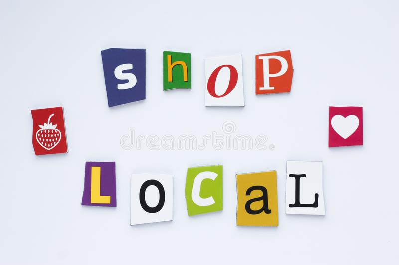A word writing text showing shop local from cut letters on white background. Shopping concept. Rubric shop local. Text space. royalty free stock photo