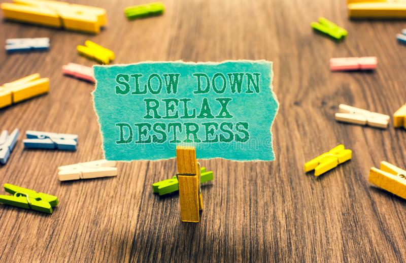 Word writing text Slow Down Relax Destress. Business concept for calming bring happiness and put you in good mood Clothespin holdi stock image