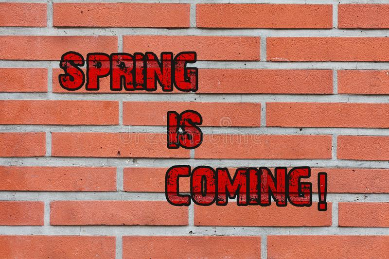 Word writing text Spring Is Coming. Business concept for season after winter in which vegetation begins to appear Brick. Word writing text Spring Is Coming royalty free stock photography