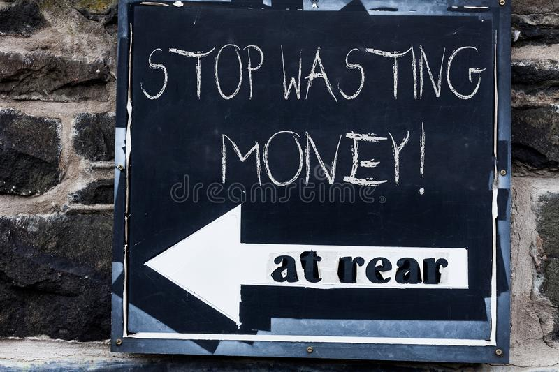 Word writing text Stop Wasting Money. Business concept for advicing demonstrating or group to start saving and use it. Word writing text Stop Wasting Money royalty free stock photo