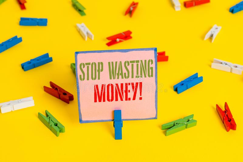 Word writing text Stop Wasting Money. Business concept for advicing demonstrating or group to start saving and use it. Word writing text Stop Wasting Money royalty free stock photography