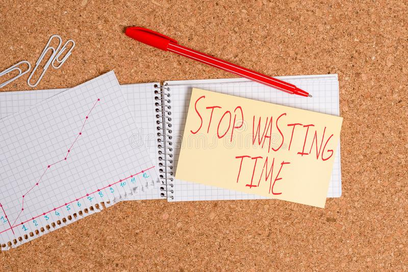 Word writing text Stop Wasting Time. Business concept for advising demonstrating or group start planning and use it Desk. Word writing text Stop Wasting Time royalty free stock photography