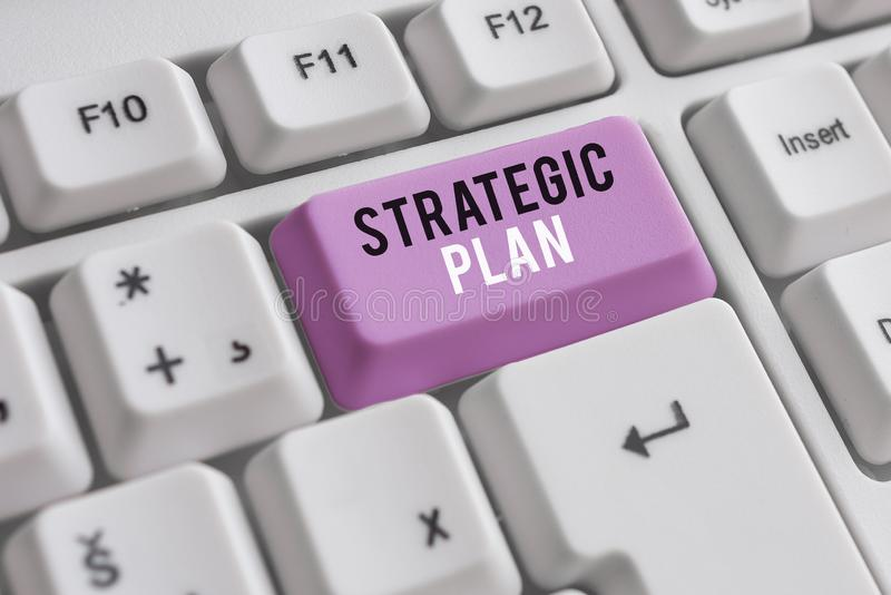 Word writing text Strategic Plan. Business concept for a systematic process of envisioning a desired future White pc. Word writing text Strategic Plan. Business royalty free stock image