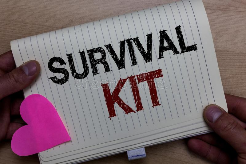 Word writing text Survival Kit. Business concept for Emergency Equipment Collection of items to help someone Man holding notebook. Paper heart Romantic ideas royalty free stock photography
