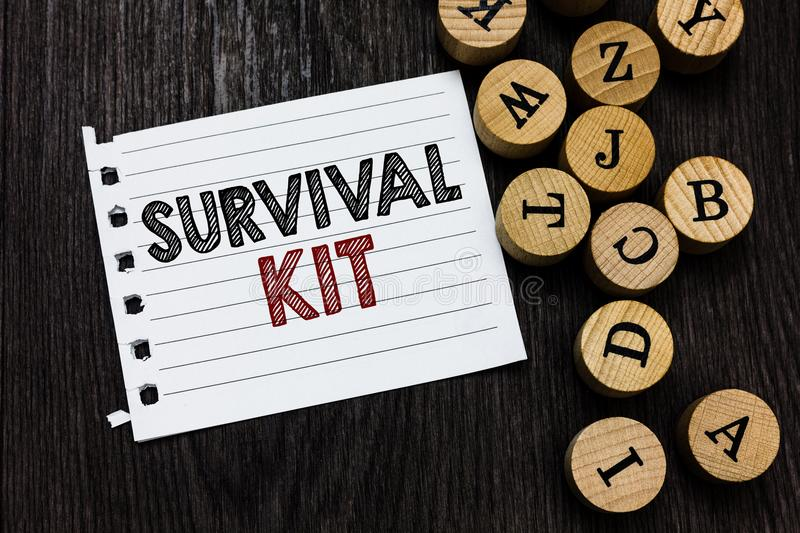 Word writing text Survival Kit. Business concept for Emergency Equipment Collection of items to help someone Piece notebook paper. Circle letters ideas stock image