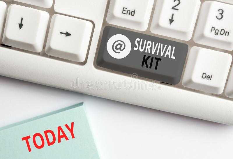 Word writing text Survival Kit. Business concept for Emergency Equipment Collection of items to help someone White pc. Word writing text Survival Kit. Business stock image