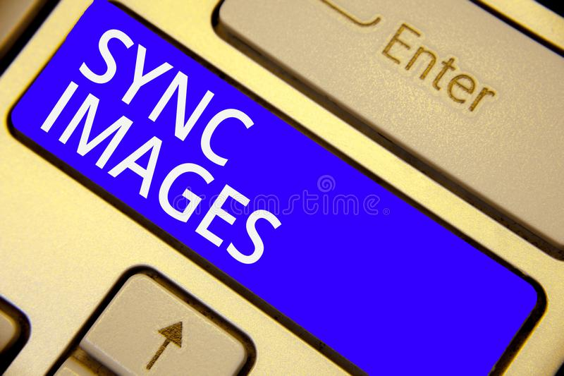 Word writing text Sync Images. Business concept for Making photos identical in all devices Accessible anywhere Keyboard blue key I. Ntention create computer royalty free stock image