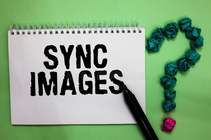 Word writing text Sync Images. Business concept for Making photos identical in all devices Accessible anywhere Notebook marker cru. Mpled papers forming question stock photos