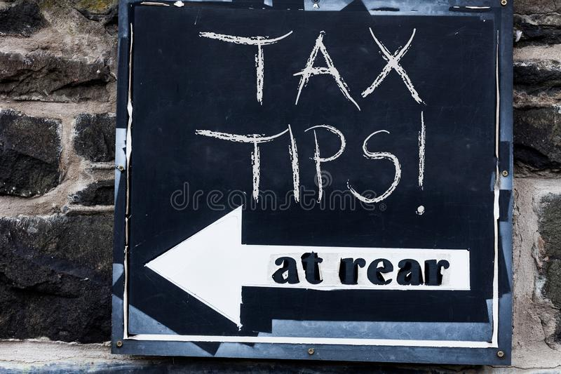 Word writing text Tax Tips. Business concept for compulsory contribution to state revenue levied by government. Word writing text Tax Tips. Business photo royalty free stock images
