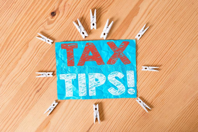 Word writing text Tax Tips. Business concept for compulsory contribution to state revenue levied by government Colored. Word writing text Tax Tips. Business stock images