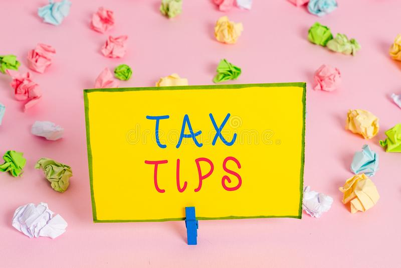 Word writing text Tax Tips. Business concept for compulsory contribution to state revenue levied by government Colored. Word writing text Tax Tips. Business stock image