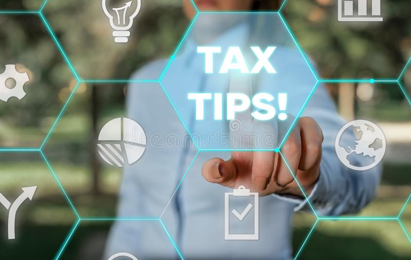 Word writing text Tax Tips. Business concept for compulsory contribution to state revenue levied by government Female. Word writing text Tax Tips. Business photo royalty free stock photos