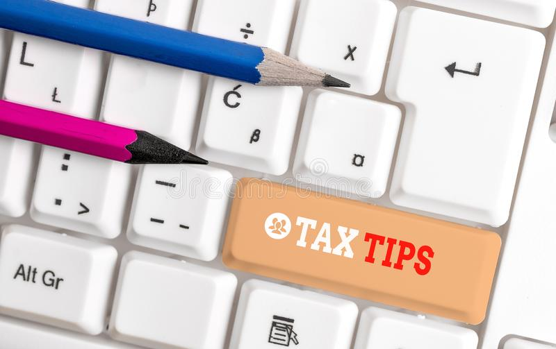 Word writing text Tax Tips. Business concept for compulsory contribution to state revenue levied by government White pc. Word writing text Tax Tips. Business stock images