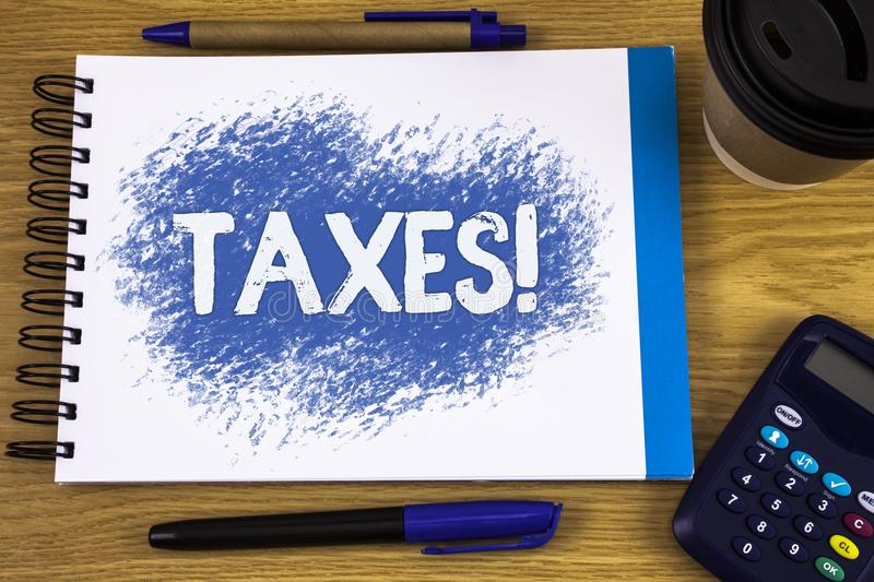 Word writing text Taxes Motivational Call. Business concept for Money demanded by a government for its support written on Notepad. Word writing text Taxes royalty free stock images