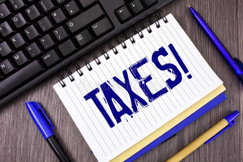 Word writing text Taxes Motivational Call. Business concept for Money demanded by a government for its support written on Notepad. Word writing text Taxes stock image