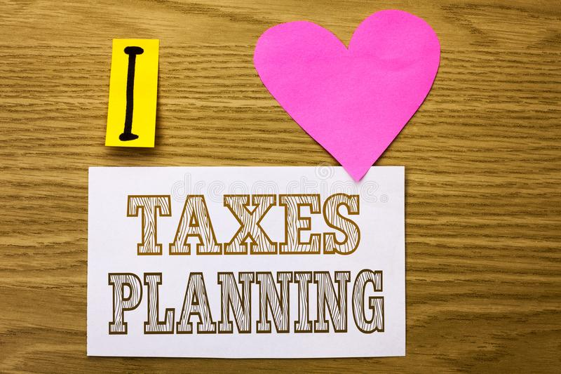 Word writing text Taxes Planning. Business concept for Financial. Planification Taxation Business Payments Prepared written Sticky Note Paper the wooden royalty free stock photography