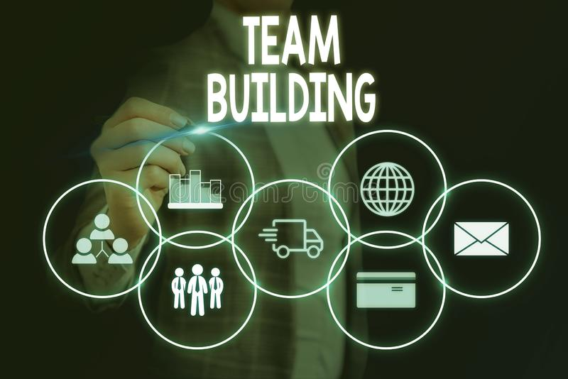Word writing text Team Building. Business concept for various types of activities used to enhance social relations Woman. Word writing text Team Building royalty free stock photos