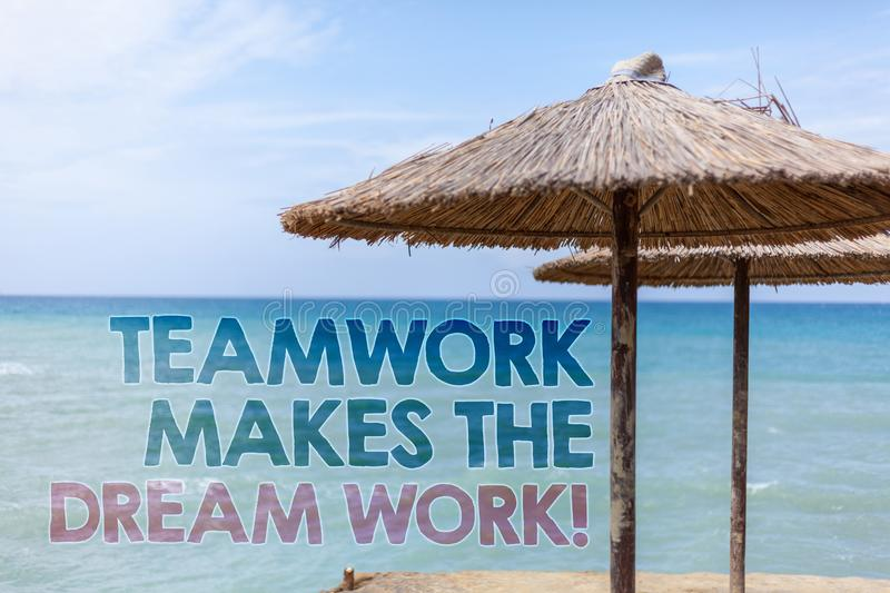 Word writing text Teamwork Makes The Dream Work Call. Business concept for Camaraderie helps achieve success Blue beach water That. Ched Straw Umbrellas Message royalty free stock image