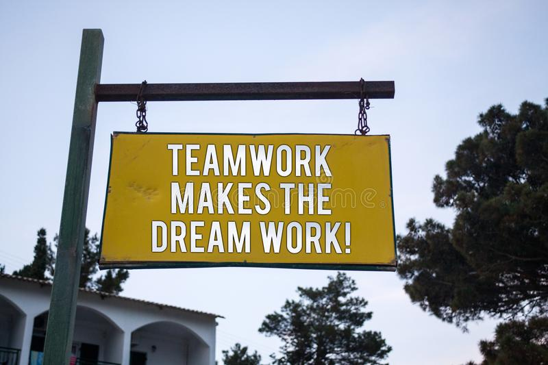 Word writing text Teamwork Makes The Dream Work Call. Business concept for Camaraderie helps achieve success Wooden board hang han. Ging post ideas messages royalty free stock photos