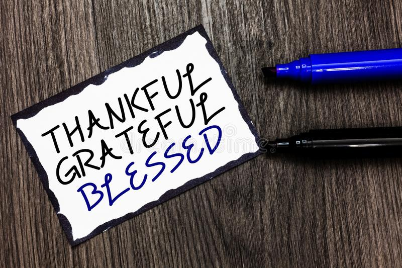 Word writing text Thankful Grateful Blessed. Business concept for Appreciation gratitude good mood attitude Black. Bordered page with texts laid black and blue royalty free stock photography