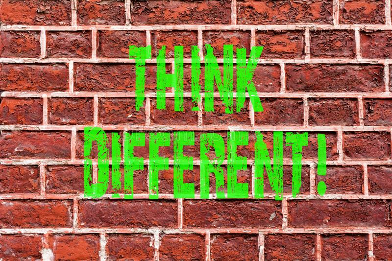 Word writing text Think Different. Business concept for Rethink Change on vision Acquire New Ideas Innovate Brick Wall art like. Graffiti motivational call royalty free stock photography