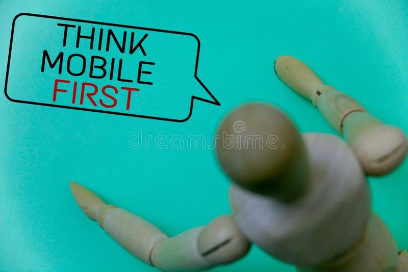 Word writing text Think Mobile First. Business concept for Handheld devises marketing target portable phones first Cyan background. Robot imaginations idea royalty free stock images