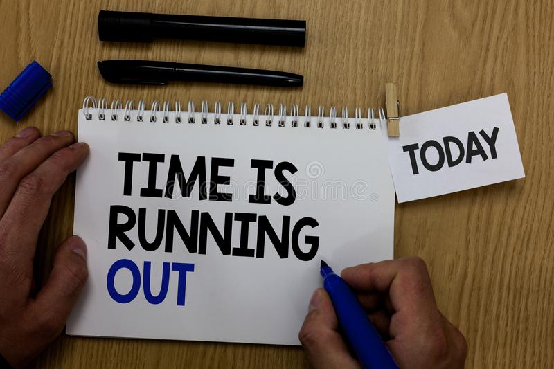 Word writing text Time Is Running Out. Business concept for Deadline is approaching Urgency things cannot wait Hand hold pen notep stock photo