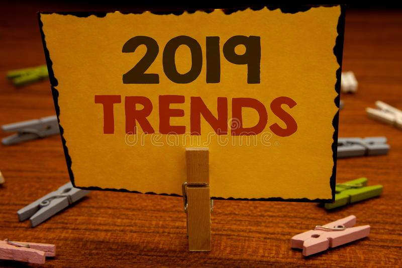 Word writing text 2019 Trends. Business concept for New year developments in fashion Changes Innovations ModernClothespin hold hol. Words writing texts 2019 royalty free stock image
