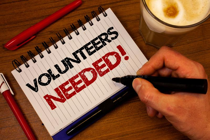Word writing text Volunteers Needed Motivational Call. Business concept for Social Community Charity Volunteerism Hand grasp black. Marker wooden desk red pen stock photos