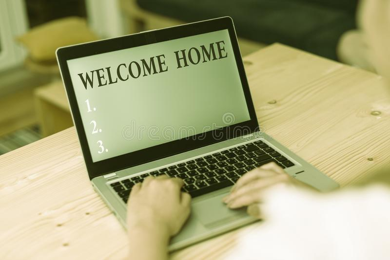 Word writing text Welcome Home. Business concept for Expression Greetings New Owners Domicile Doormat Entry woman laptop. Word writing text Welcome Home stock images