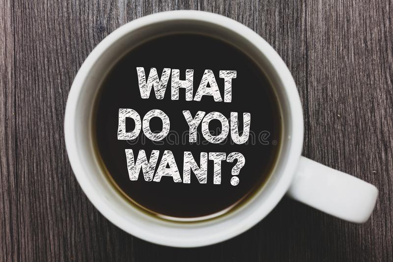 Word writing text What Do You Want question. Business concept for Tell me your desires requests demands ambition Black coffee with. Coffee mug floating texts on stock photography