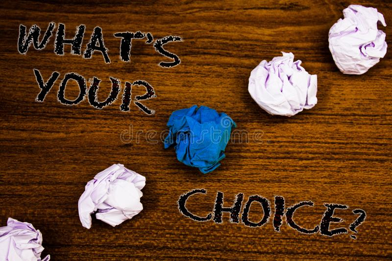 Word writing text What S Your Choice Question. Business concept for Option Decision Preferred Opinion Preference Brown woody deskt stock photos