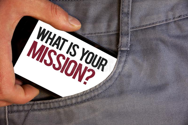 Word writing text What Is You Mission Question. Business concept for asking someone about his plans and to-do list Personage hand. Pushing mobile phone into stock photography