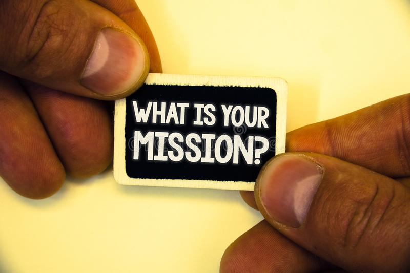 Word writing text What Is You Mission Question. Business concept for asking someone about his plans and to-do list Two hands hold. Small black card focused stock photography