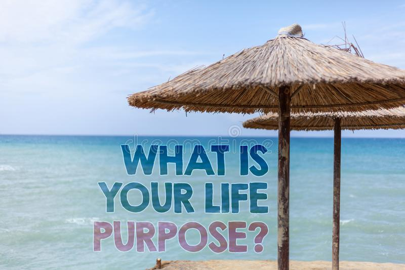 Word writing text What Is Your Life Purpose Question. Business concept for Personal Determination Aims Achieve Goal Blue beach wat. Er Thatched Straw Umbrellas stock photography