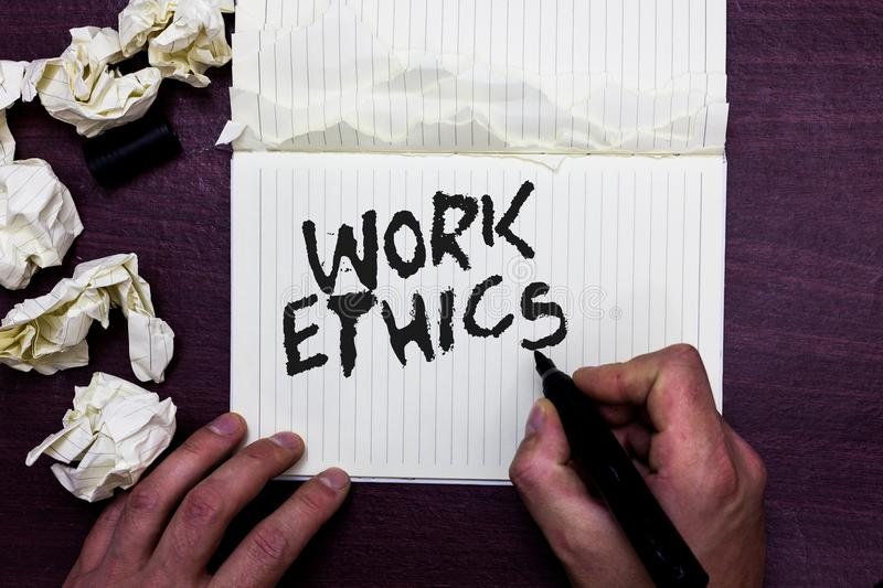 Word writing text Work Ethics. Business concept for A set of values centered on the importance of doing work Man holding marker no. Tebook page crumpled papers stock images