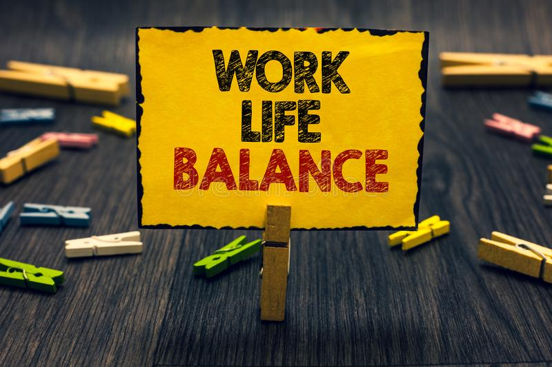 Word writing text Work Life Balance. Business concept for Division of time between working or family and leisure Blacky wooden des stock images
