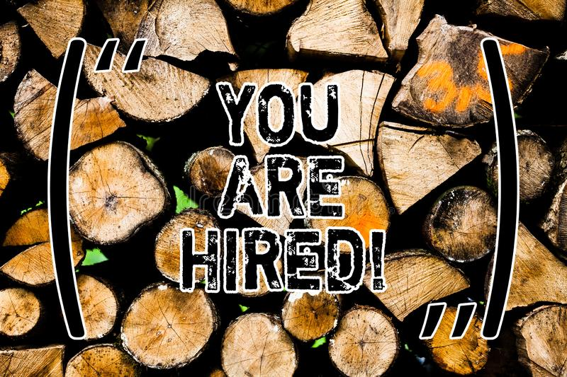 Word writing text You Are Hired. Business concept for Recruitment being selected for a job the right candidate Wooden royalty free stock photography